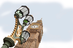 three bracket green and gold lamp post on westminster bridge, big ben behind