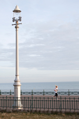 lamp post and jogger on brighton promenade