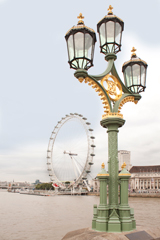 three backet lamp post on westminster bridge, view to the london eye
